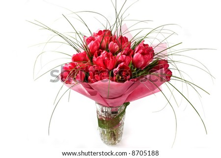 Bouquet of tulips in the crystal vase. Isolated on white.