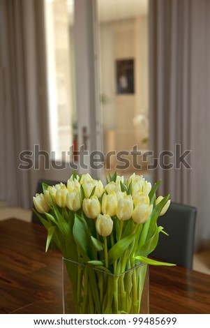 Bouquet of tulips in the living room of a house - stock photo