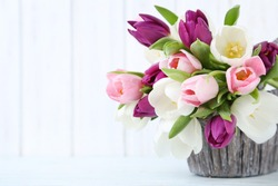 Bouquet of tulips on a wall paneling background