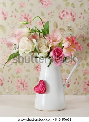 Bouquet of white and pink roses in the pot decorated by heart