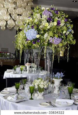 Bouquet of white flower in vase of glass. Decoration of dining table.