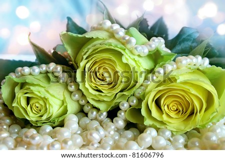 Bouquet of white roses lying on the pearl