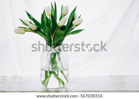 Bouquet of white tulips in a vase #567030316