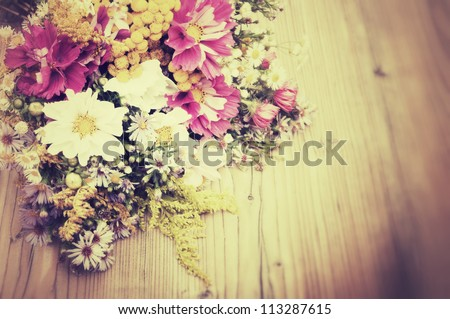 Bouquet of Wild Summer Flowers on Wooden Table - Vintage Look