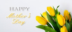 Bouquet of yellow tulips with congratulations on Mother's Day
