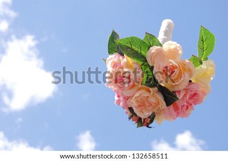bouquet toss in the sky