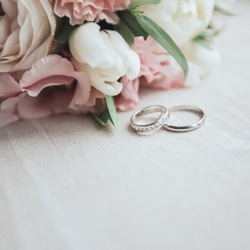 Bouquet with beautiful roses and wedding rings