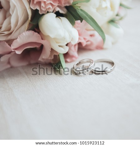 Bouquet with beautiful roses and wedding rings #1015923112