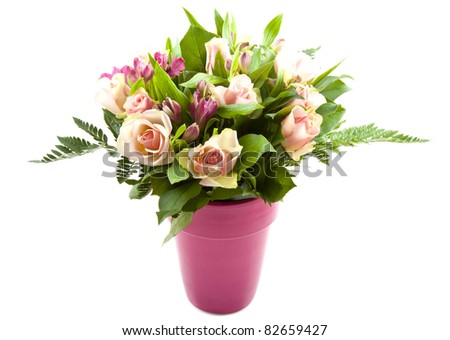 Bouquet with different kind of colorful flowers in a pink vase