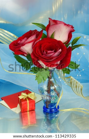 Bouquet with pink and red roses in a glass vase