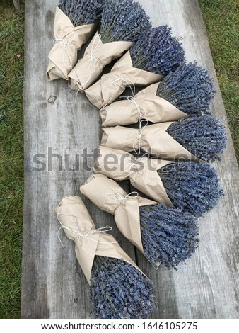 Bouquets of dry lavender in kraft packaging. Fragrant dried flowers.