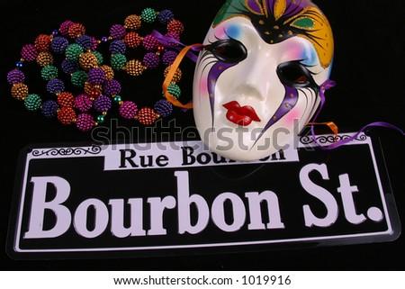 Bourbon Street, beads and single mardi Gras mask.