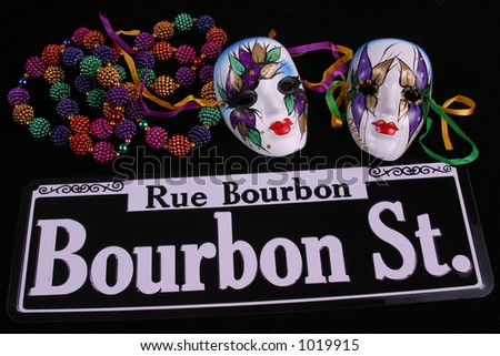 Bourbon Street sign, beads and two masks for Mardi gras.