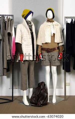 Boutique display mannequins in fashionable dresses