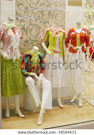 Boutique window with dressed mannequins - stock photo