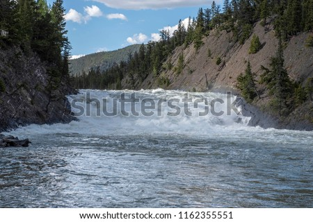 Bow Falls is a major waterfall on the Bow River, Alberta just before the junction of it and the Spray River. The falls are located near the Banff Springs Hotel and golf course on the left-hand side of