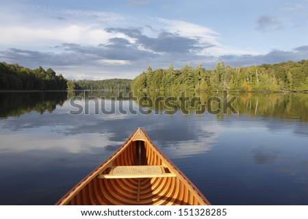 Bow of a Cedar Canoe on a Tranquil Lake - Ontario, Canada