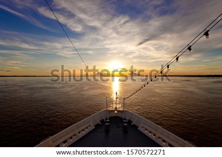 Bow of a ship in Amazon River at sunset near Manaus, Brazil