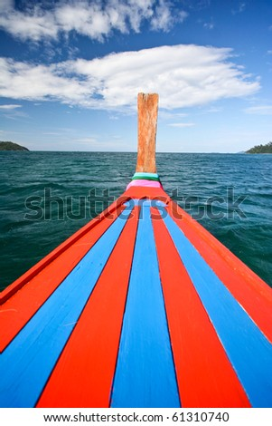 Bow of a traditional thai longtail boat in sea