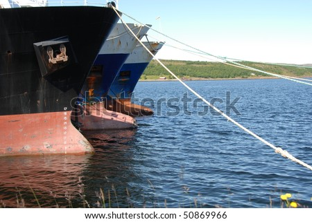 Bow of ships in harbor