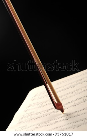 bow on a music sheet