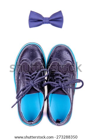 bow tie and modern shoes are isolated on white background