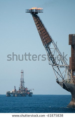 Bow view of an FPSO ol rig in offshore area.  Another drilling rig as background.  Coast of Brazil, 2010.