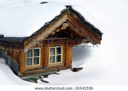 Bow-window of a chalet in a ski resort. - stock photo