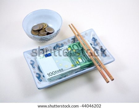 bowl and dish full of euros with chopsticks
