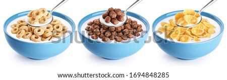 Bowl and spoon with corn rings, balls, cornflakes and yogurt isolated on white background. Cereals breakfast collection with clipping path. Сток-фото ©