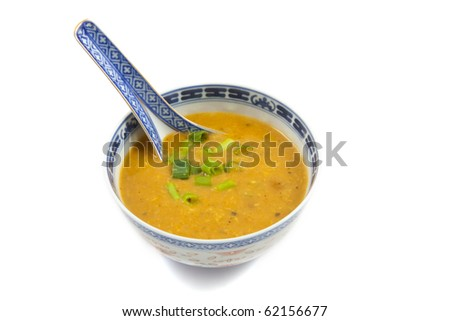 Bowl filled with chinese soup isolated over white