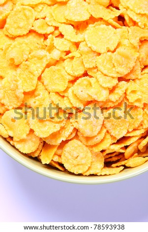 Bowl full of cornflakes. Top view