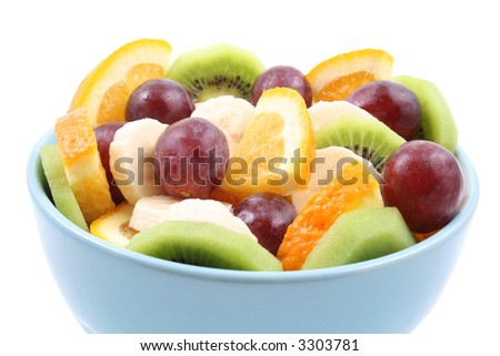 bowl full of delicious fruit salad - kiwi banana orange and grapes - isolated on white - stock photo