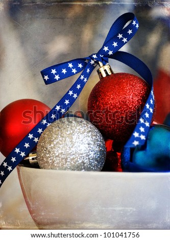 Bowl full of red white &blue Christmas ornaments with an old flag background for a patriotic Christmas theme - aged with a texture