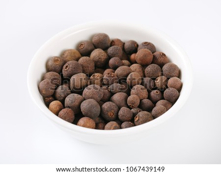 bowl of allspice berries on white background #1067439149