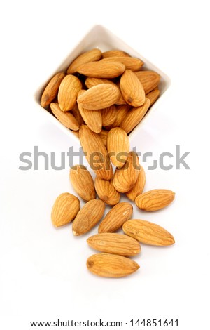 Bowl of almonds  on white