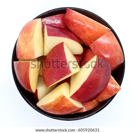 bowl of apple slices on white background