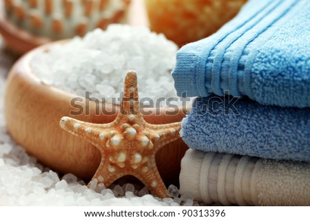 bowl of aromatic bath salt and pile of towels - beauty treatment /shallow dof/