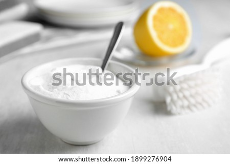Bowl of baking soda on white table, space for text Photo stock ©
