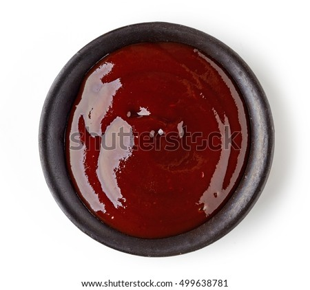 Bowl of barbecue sauce on white background, top view
