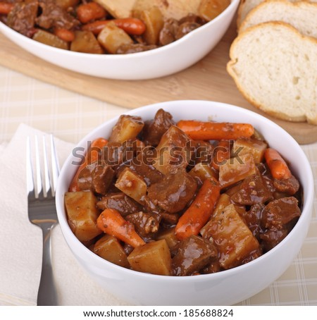 Bowl of beef stew with carrots and potatoes #185688824
