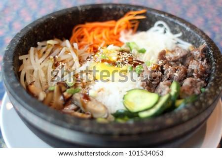 Bowl of bibimbap in a stone bowl at a Korean restaurant.