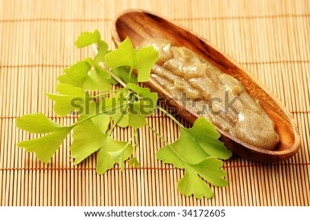 bowl of body scrub with ginko leaves - beauty treatment