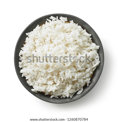 bowl of boiled rice isolated on white background, top view