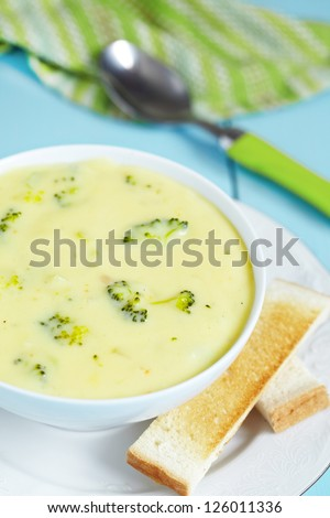 Bowl of broccoli and cheddar cheese soup