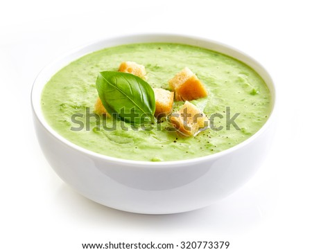 bowl of broccoli and green peas cream soup isolated on white background
