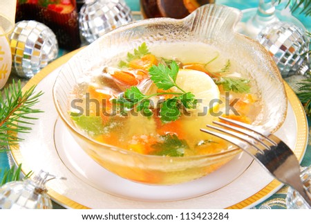 bowl of carp in jelly with carrot and parsley as traditional polish dish on christmas table