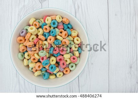 Shutterstock Bowl of Cereal, Colorful cereal in a bowl on weathered wood