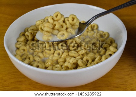 bowl of cereal with cereal on a spoon  #1456285922