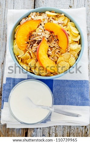 Bowl of cereal with muesli and fresh peach